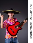 man wearing sombrero with guitar | Shutterstock . vector #230684773