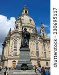 Small photo of DRESDEN, GERMANY - JUNE, 26th, 2014: Frauenkirche (Church of Virgine Mary) one of most famous landmark of Dresden with Martin Lither monument in front on 26th June 2013.