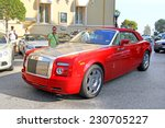 Small photo of MONTE CARLO, MONACO - AUGUST 2, 2014: Red british premium class car Rolls-Royce Phantom Drophead Coupe at the city street near the casino.
