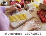 woman hands wrapping christmas... | Shutterstock . vector #230710873