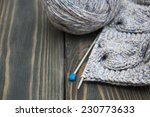 knitting and needles on rustic... | Shutterstock . vector #230773633