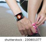 female hand tying shoelaces... | Shutterstock . vector #230801377