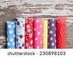 rolls of colorful patterned...