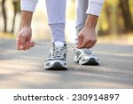runner feet on road  outdoors | Shutterstock . vector #230914897