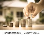 male hand putting money coins... | Shutterstock . vector #230949013