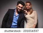 happy fashion couple leaning on ... | Shutterstock . vector #231016537