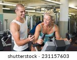 smiling male trainer timing his ... | Shutterstock . vector #231157603