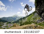 mountainbiker jumping from a... | Shutterstock . vector #231182107