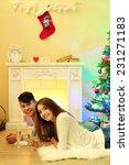 happy couple having drinks by ...   Shutterstock . vector #231271183