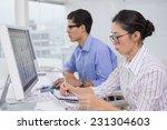 creative team working at desk... | Shutterstock . vector #231304603