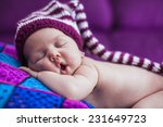 newborn baby in a  hat. | Shutterstock . vector #231649723