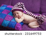 newborn baby girl in a knitted... | Shutterstock . vector #231649753