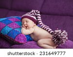 newborn  in a knitted pink and... | Shutterstock . vector #231649777