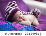 newborn baby girl in a knitted... | Shutterstock . vector #231649813