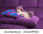 newborn baby girl in a knitted... | Shutterstock . vector #231649903