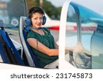 young girl seating in aircraft... | Shutterstock . vector #231745873