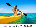 Woman Kayaking In The Ocean On...