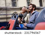 tourist couple on open top bus... | Shutterstock . vector #231796567