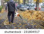Worker On A Street In Autumn...