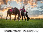 Girl And Horse At Sunset