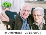 Senior Couple Showing Self...