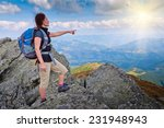 young woman standing on a rock...   Shutterstock . vector #231948943