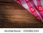 top view of checkered napkin on ... | Shutterstock . vector #232082143