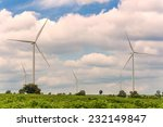 eco power in wind turbine farm | Shutterstock . vector #232149847