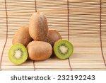 kiwi fruit on wood background. | Shutterstock . vector #232192243