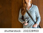 young woman with a retro camera ... | Shutterstock . vector #232228903