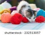 Stock photo white kitten plays with balls of yarn 232513057
