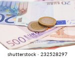 money euro coins and banknotes  | Shutterstock . vector #232528297
