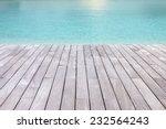 Wooden Platform Beside The Blu...