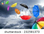 flying umbrellas in front of... | Shutterstock . vector #232581373