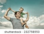 son seating on the father under ... | Shutterstock . vector #232758553