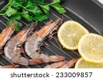 raw shrimps on black pan. whole ... | Shutterstock . vector #233009857