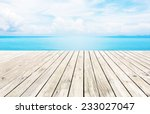 Wooden Pier With Blue Sea And...