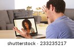 man webcamming with friend on... | Shutterstock . vector #233235217