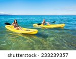 Couple Kayaking In The Ocean O...