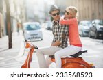 Glamorous  Young Couple Riding...