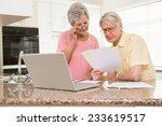 Senior Couple Paying Their...