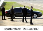Small photo of BELGRADE, SERBIA - CIRCA OCTOBER 2014: Security officers protects car with VIP person, circa October 2014 in Belgrade