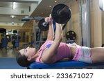 women with barbells in gym | Shutterstock . vector #233671027