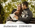 happy couple using tablet...   Shutterstock . vector #233848303