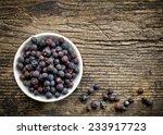 Bowl Of Juniper Berries On Old...