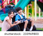 sister sitting next to disabled ... | Shutterstock . vector #233969803
