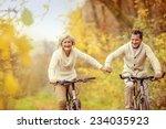 active seniors riding bike in... | Shutterstock . vector #234035923