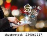 business woman sending email  | Shutterstock . vector #234061117