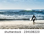 sunrise image of surfers at the ... | Shutterstock . vector #234108223