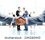 close up of businessmen shaking ... | Shutterstock . vector #234260443